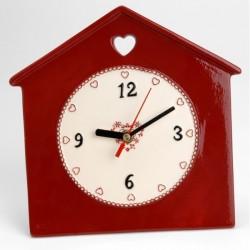 Gros plan aiguille  horloge murale déco rouge